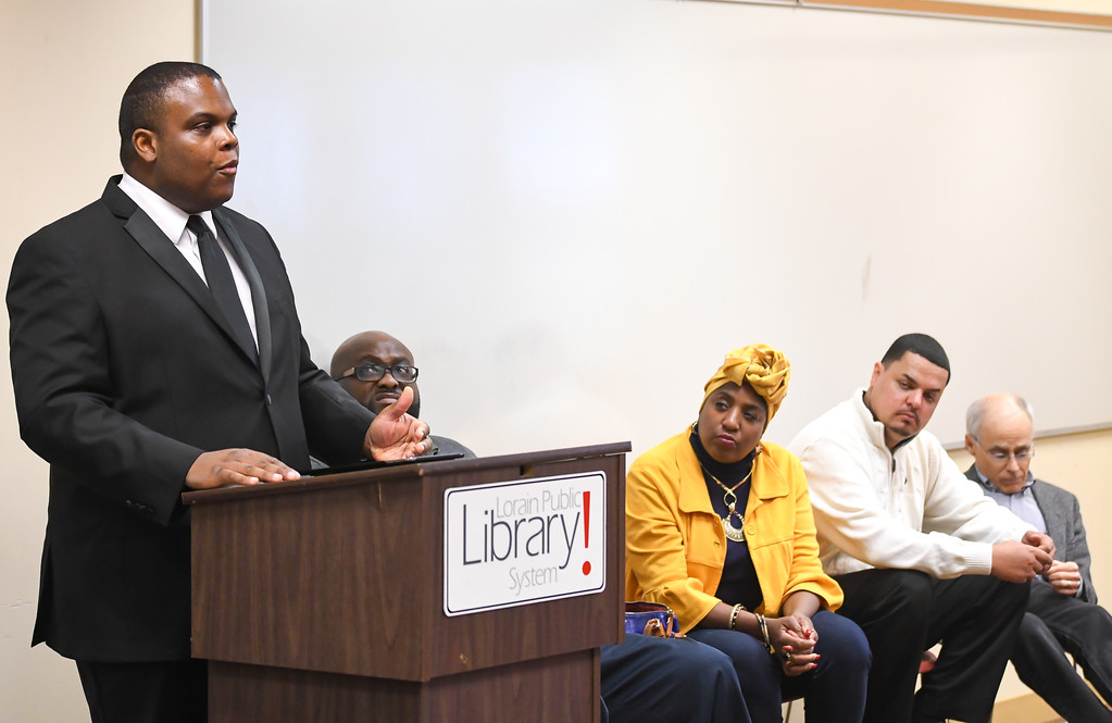 ". Local author Robert J. Moore Jr. leads a panel discussion at the Lorain Public Library\'s South Lorain Branch, Jan. 16, 2017. The Interfaith Ministries of Lorain County sponsored event ""Liberty and Justice for All\"" brought civic leaders and the general public together to remember the legacy of Dr. Martin Luther King Jr. and to generate open dialogue in hopes of finding ways to unify the community. (Eric Bonzar/The Morning Journal)"