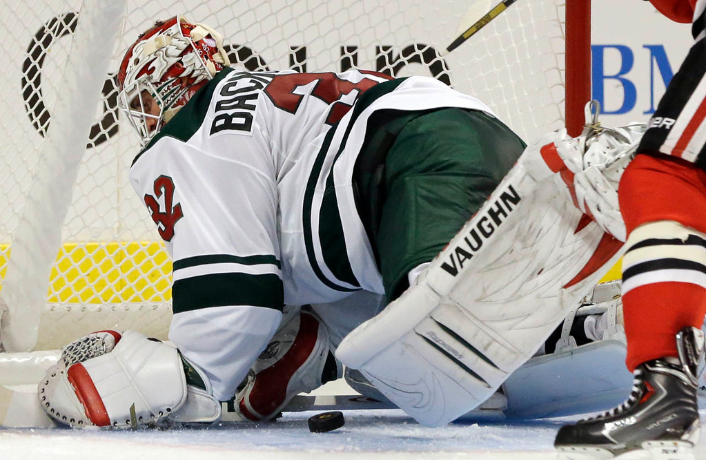 . Minnesota Wild goalie Niklas Backstrom (32) saves a shot by Chicago Blackhawks\' Patrick Sharp (10) during the second period. (AP Photo/Nam Y. Huh)