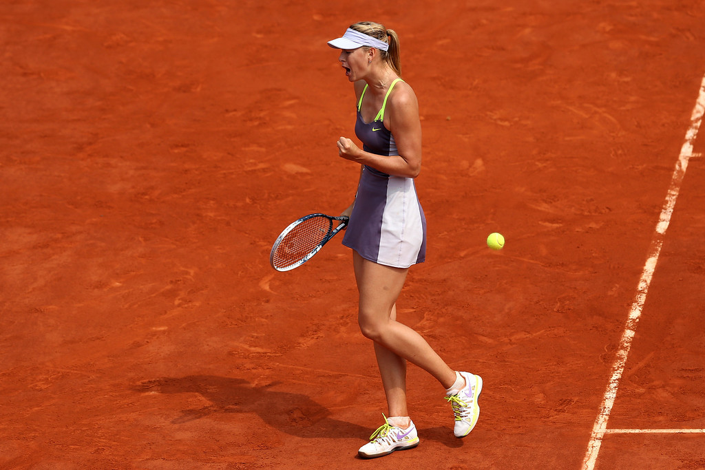 . Maria Sharapova of Russia celebrates a point in her Women\'s Singles Final match against Serena Williams of United States of America during day fourteen of French Open at Roland Garros on June 8, 2013 in Paris, France.  (Photo by Clive Brunskill/Getty Images)