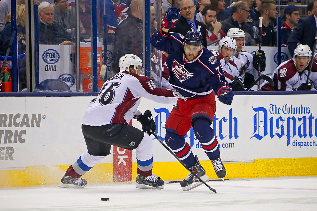 . COLUMBUS, OH - APRIL 1:  Nick Foligno #71 of the Columbus Blue Jackets jumps past Cory Sarich #16 of the Colorado Avalanche in order to continue chasing after the puck during the second period on April 1, 2014 at Nationwide Arena in Columbus, Ohio. (Photo by Kirk Irwin/Getty Images)