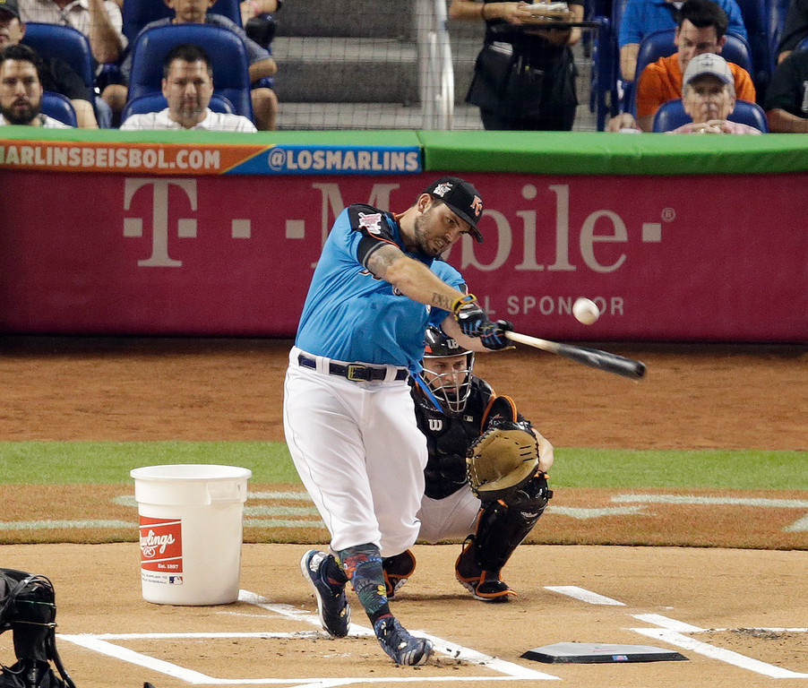. Kansas City Royals\' Mike Moustakas hits a home run during the MLB baseball All-Star Home Run Derby, Monday, July 10, 2017, in Miami. (AP Photo/Lynne Sladky)