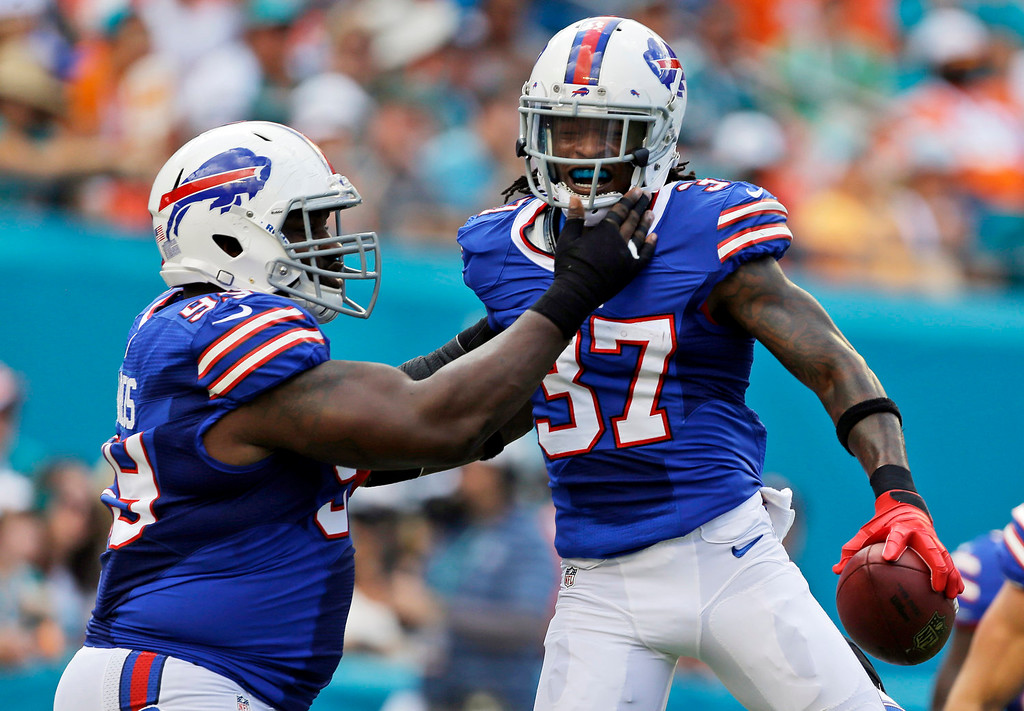 . Buffalo Bills defensive back Nickell Robey (37) is congratulated by Bills defensive tackle Marcell Dareus (99) after Robey intercepted a pass and scored a touchdown during the first half of an NFL football game against the Miami Dolphins, Sunday, Oct. 20, 2013, in Miami Gardens, Fla. (AP Photo/Lynne Sladky)