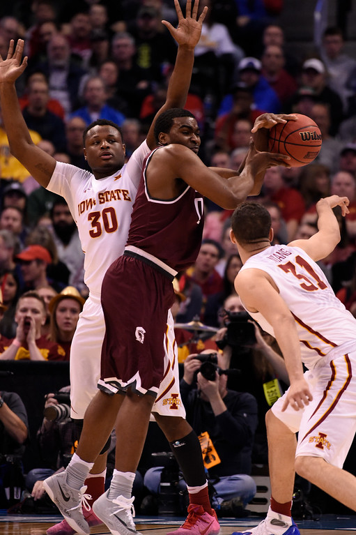 . DENVER, CO - MARCH 19: Arkansas Little Rock Trojans forward Roger Woods (0) loses control of the ball as Iowa State Cyclones guard Deonte Burton (30) defends on the play  in the first half during the second round of the men\'s basketball game in the NCAA Tournament March19, 2016 at Pepsi Center in Denver. (Photo By John Leyba/The Denver Post)