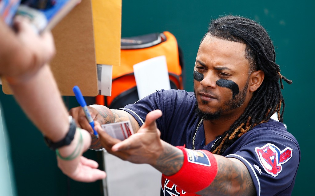 . Cleveland Indians second baseman Michael Martinez signs autographs for fans prior to a spring training baseball game against the Colorado Rockies Friday, March 3, 2017, in Goodyear, Ariz. The Rockies defeated the Indians 16-7. (AP Photo/Ross D. Franklin)