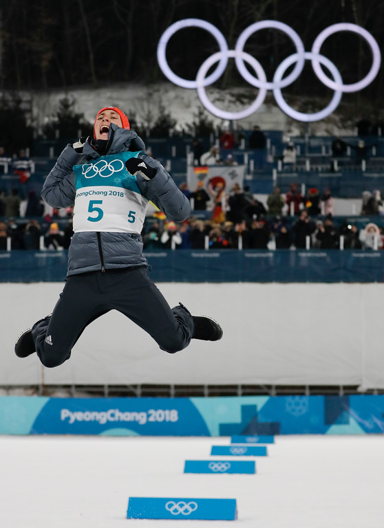 . Gold medal winner Eric Frenzel, of Germany, celebrates during the venue ceremony after the 10km cross-country skiing portion of the nordic combined event at the 2018 Winter Olympics in Pyeongchang, South Korea, Wednesday, Feb. 14, 2018. (AP Photo/Kirsty Wigglesworth)