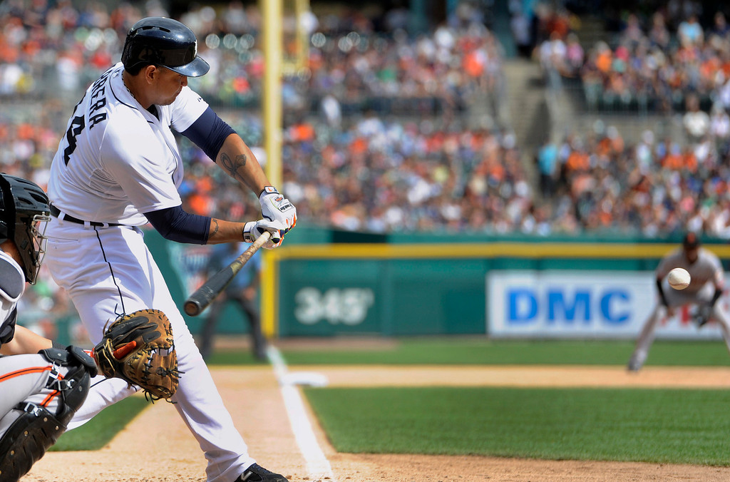 . Detroit Tigers\' Miguel Cabrera hits a home run against the San Francisco Giants in the eighth inning of a baseball game Saturday, Sept. 6, 2014, in Detroit.  The Giants won 5-4.  (AP Photo/Jose Juarez)