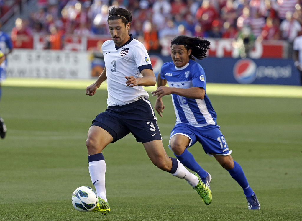 . Honduras\' Roger Espinoza (15) defends as United States\' Omar Gonzalez (3) clears the ball in the first half during a World Cup qualifying soccer match at Rio Tinto Stadium on Tuesday, June 18, 2013, in Sandy, Utah.  (AP Photo/Rick Bowmer)