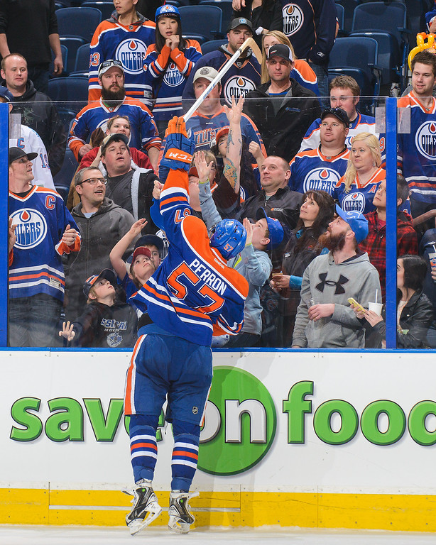 . David Perron #57 of the Edmonton Oilers gives away a stick on fan appreciation night during an NHL game at Rexall Place on April 8, 2014 in Edmonton, Alberta, Canada. The Avalanche defeated the Oilers 4-1. (Photo by Derek Leung/Getty Images)