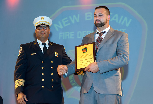 09/20/18 Wesley Bunnell | Staff The New Britain Fire Department held their 2018 Awards Ceremony on Thursday September 20 at Trinity on Main. Fire Chief Raul Ortiz presented an award a representative from D&L Auto Body & Towing for exemplary performance in the rescue and extrication during excessive heat and weather conditions which contributed to the successful rescue of a patient.