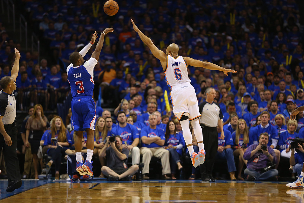 . Chris Paul #3 of the Los Angeles Clippers takes a shot against Derek Fisher #6 of the Oklahoma City Thunder in Game One of the Western Conference Semifinals during the 2014 NBA Playoffs at Chesapeake Energy Arena on May 5, 2014 in Oklahoma City, Oklahoma.   (Photo by Ronald Martinez/Getty Images)