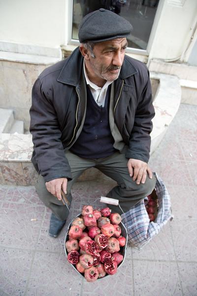 Baku, Azerbaijan - February 2008: Azeri man selling pomegranates in downtown Baku, Azerbaijan. (Photo by Christopher Herwig)