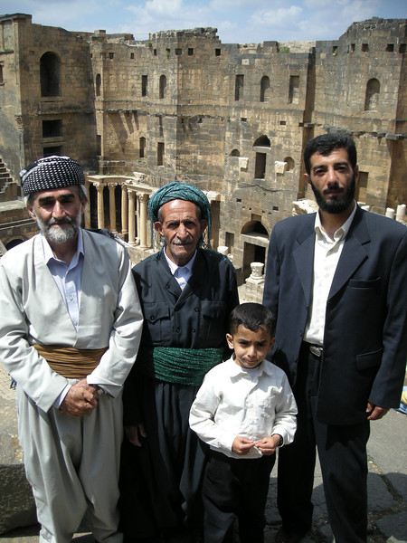 a Kurdish-Iranian family at the Roman theatre in Bosra, Syria