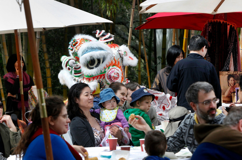 """. A dragon makes its way back to the stage at Hakone Estate and Gardens during a Lunar New Year of the Snake festival with a \""""Chinese Village Fair\"""" on Sunday afternoon, March 3, 2013 in Saratoga, Calif. (Karl Mondon/Staff)"""