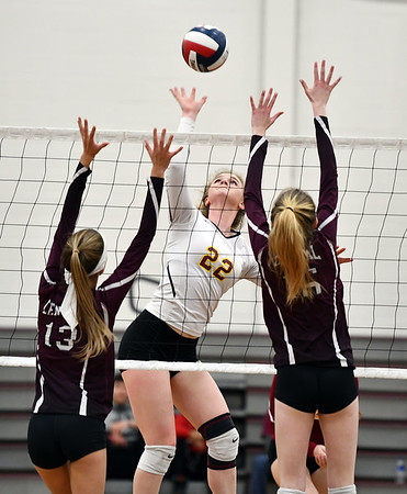 11/14/2019 Mike Orazzi | StaffrBristol Central High School's Emily Ericson (13) and Kayla St. Onge (16) and St. Joseph's Lily Mattison (22) during the Class L Second Round Girls Volleyball Tournament at BCHS. r