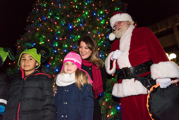 11/29/18 Wesley Bunnell | Staff New Britain held their tree lighting ceremony with a visit from Santa on Thursday evening at Central Park. Gamiel Rodriguez, age 7, and Ava Scofield, age 5, stand with Mayor Erin Stewart and Santa Claus after helping push the tree lighting button.
