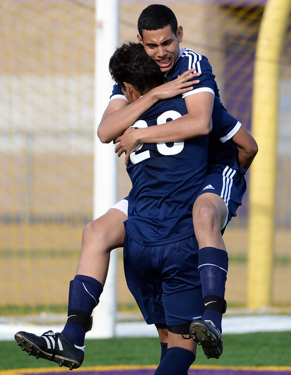 . Baldwin Park\'s Daniel Penate jumps into the arms of Danny Vega (20) after Vega scores on a penalty kick in the first half of a CIF-SS quarterfinal prep playoff soccer match against Diamond Bar at Diamond Bar High School in Diamond Bar, Calif., on Thursday, Feb.27, 2014. Baldwin Park won 2-1. (Keith Birmingham Pasadena Star-News)