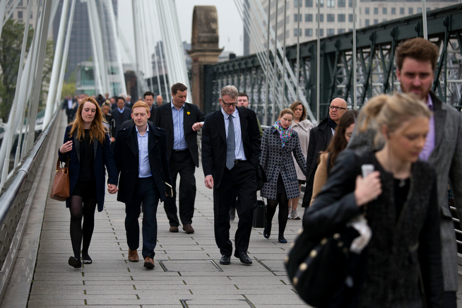 . People walk across one of the two pedestrian Golden Jubilee Bridges during a 48 hour workers strike partially closing the London Underground train network in London, Tuesday, April 29, 2014.  Members of the Rail, Maritime and Transport Union are going on strike over management plans to close all ticket offices on the subway network, known as the Tube, which will result in around 750 job losses from the Underground\'s staff of 18,000.  A further 72 hour strike is planned starting May 5.  (AP Photo/Matt Dunham)