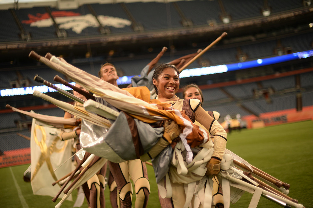 . DENVER, CO - JULY 12: Dancers of Pacific Crest from Diamond Bar, CA leave the field after their performance for Drums Along the Rockies in Denver, Colorado July 12, 2014. One of the Rocky Mountain region\'s most-anticipated summertime music attractions for more than 50 years returned to Sports Authority Field at Mile High. (Photo by Hyoung Chang/The Denver Post)