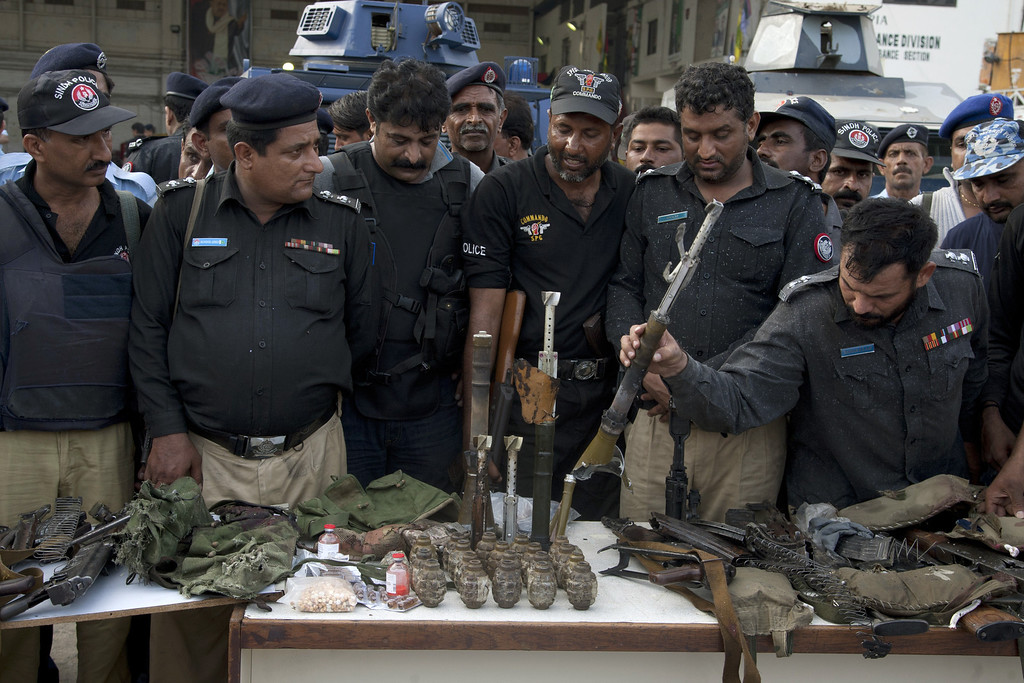 . Pakistani police officers display ammunition confiscated from attackers at the Jinnah International Airport, Monday, June 9, 2014, in Karachi, Pakistan. (AP Photo/Shakil Adil)