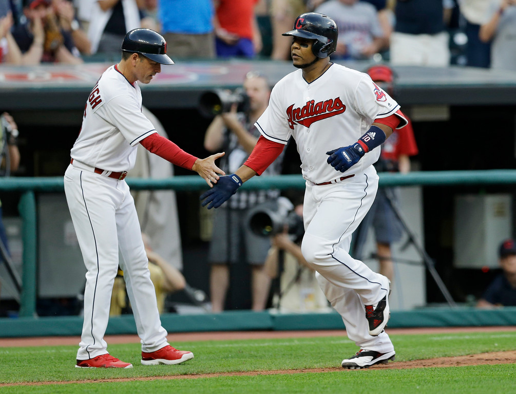 . Cleveland Indians\' Edwin Encarnacion is congratulated by third base coach Mike Sarbaugh after Encarnacion hit a two-run home run in the fourth inning of a baseball game, Saturday, June 10, 2017, in Cleveland. Michael Brantley scored on the play. (AP Photo/Tony Dejak)