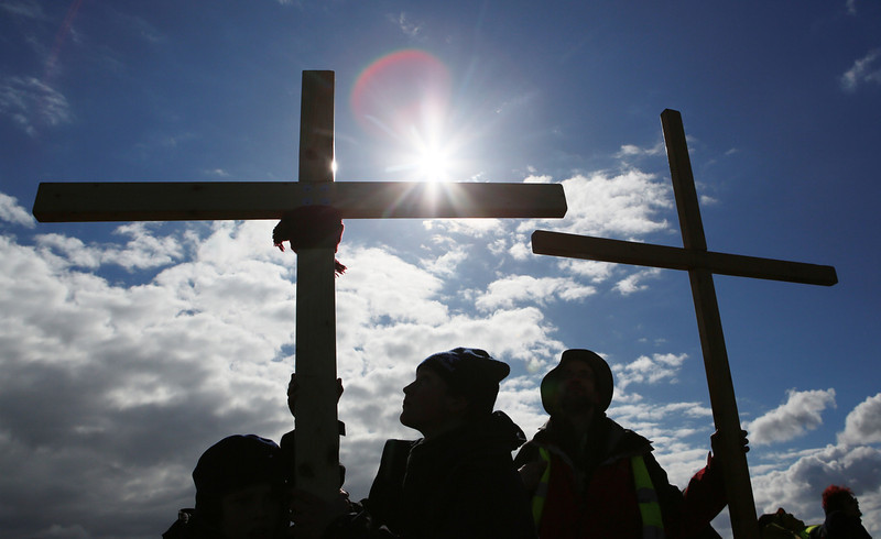 . Pilgrims hold crosses during the final leg of the Northern Cross pilgrimage to Holy Island in Northumbria, northern England March 29, 2013. For more than thirty years Christians have taken part in the pilgrimage to Holy Island, walking through Northumberland and the Scottish Borders, during Holy Week.  REUTERS/David Moir