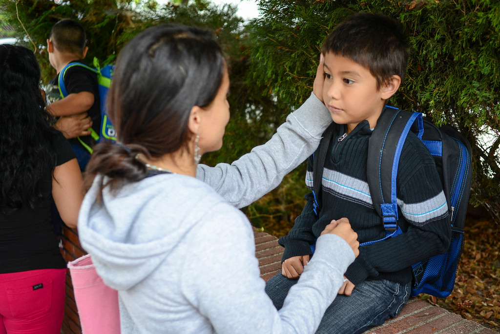 . Massiel Angel prepares her son Michael Angel, 5, for his first day of kindergarten at Fair Avenue school in North Hollywood.  Tuesday is the first day of school for the Los Angeles Unified School District. Photo by David Crane/Los Angeles Daily News