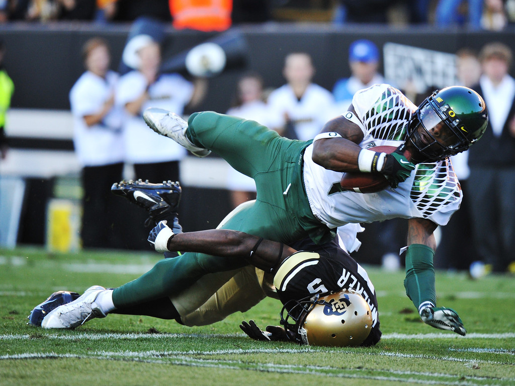 . WR Josh Huff of University of Oregon (1) scores a touchdown over DB John Walker of University of Colorado (5) in the 2nd quarter at Folsom Field. Boulder, Colorado. October 5, 2013. (Photo by Hyoung Chang/The Denver Post)
