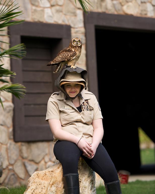 . Ashley with a Hawaiian short-eared owl. Photo by Adam Kent.
