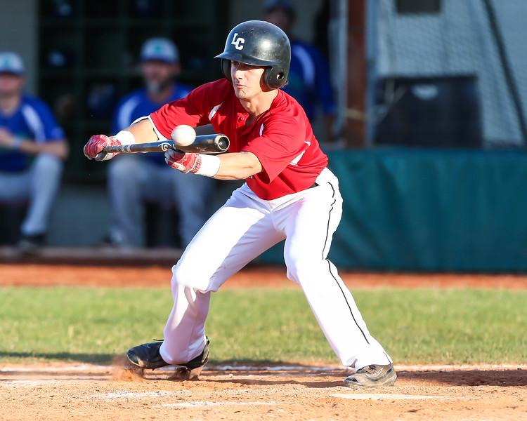 Ironmen Mathew Carpenter attempts to lay down a bunt against the Grand Lake Mariners Thursday June 15, photo Joe Colon