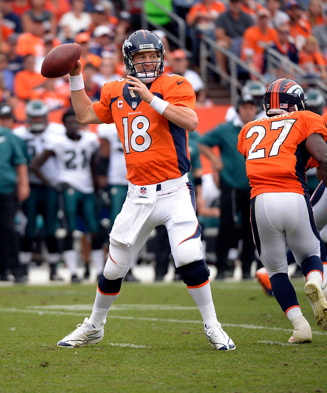 . Denver Broncos quarterback Peyton Manning (18) drops back to pass against the Philadelphia Eagles during the third quarter September 29, 2013 at Sports Authority Field at Mile High in Denver . (Photo by John Leyba/The Denver Post)
