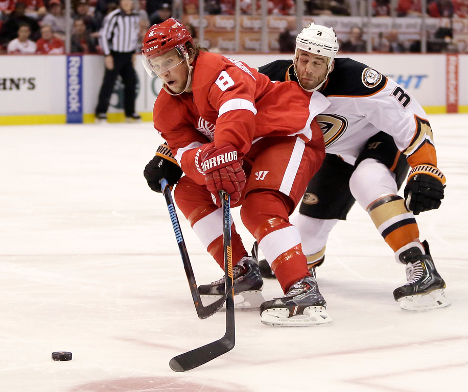. Anaheim Ducks\' Clayton Stoner (3) tries to stop Detroit Red Wings\' Justin Abdelkader (8) from skating to the goal during the second period of an NHL hockey games Saturday, Oct. 11, 2014, in Detroit. (AP Photo/Duane Burleson)