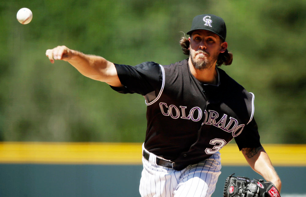. Colorado Rockies starting pitcher Christian Bergman works against the Miami Marlins in the first inning of a baseball game in Denver on Sunday, Aug. 24, 2014. (AP Photo/David Zalubowski)
