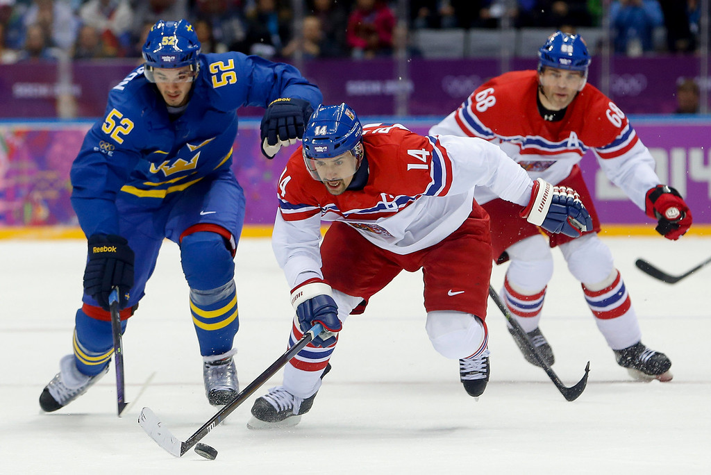 . Czech Republic forward Tomas Plekanec (14) races down the ice against Sweden defenseman Jonathan Ericsson in the first period of a men\'s ice hockey game at the 2014 Winter Olympics, Wednesday, Feb. 12, 2014, in Sochi, Russia. (AP Photo/Mark Humphrey)