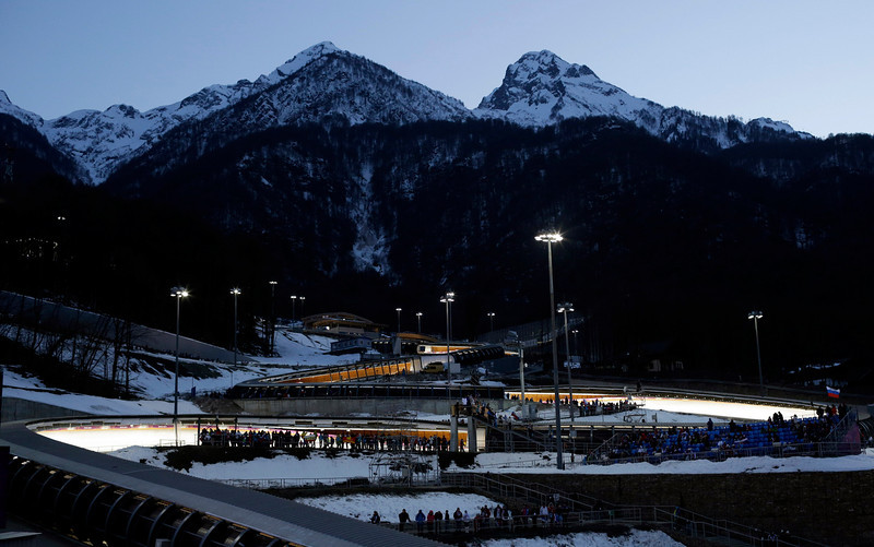 . The Sanki Sliding Center is lit up for the start of the men\'s skeleton final competition at the 2014 Winter Olympics, Saturday, Feb. 15, 2014, in Krasnaya Polyana, Russia.  (AP Photo/Felipe Dana)