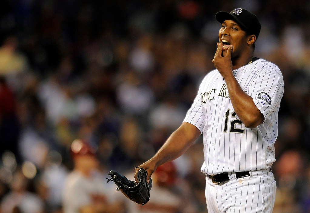 . Colorado Rockies starting pitcher Juan Nicasio walks off the mound after being pulled from the game in the sixth inning of a baseball game against the Arizona Diamondbacks on Thursday, June 5, 2014, in Denver. (AP Photo/Chris Schneider)
