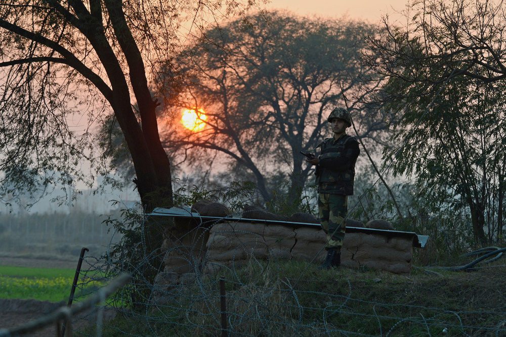 . An Indian Border Security Force (BSF) soldier keeps watch at an outpost along the India-Pakistan border in Abdulian, 38 kms southwest of Jammu, on January 9, 2013. India delivered a dressing-down to Islamabad\'s envoy to Delhi as it accused Pakistan\'s army of beheading one of two soldiers killed in Kashmir, but both sides warned against inflaming tensions. TAUSEEF MUSTAFA/AFP/Getty Images