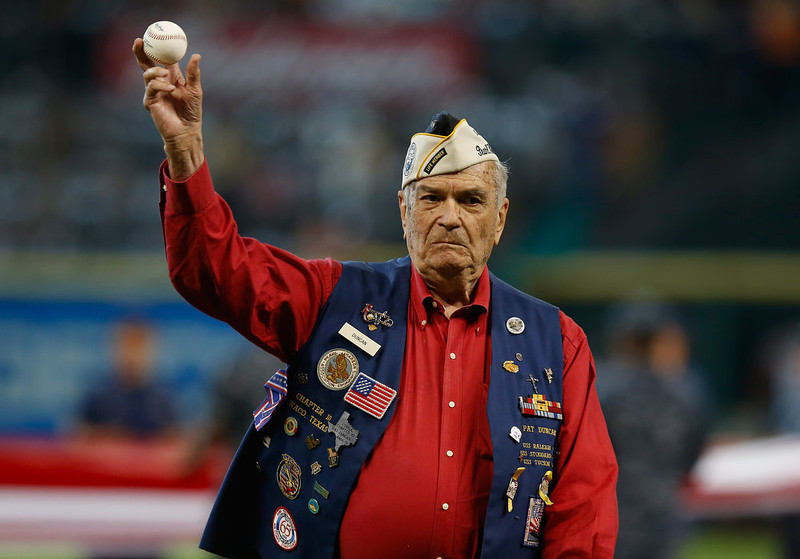 . 90 year-old World War II veteran Pat Duncan tosses out the first pitch on the field before the start of the game between the Colorado Rockies and the Houston Astros at Minute Maid Park on May 27, 2013 in Houston, Texas.  (Photo by Scott Halleran/Getty Images)