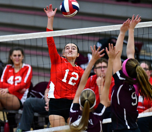 10/30/2018 Mike Orazzi | Staff Conard's Kayla Oriola (12) during the CCC volleyball tournament at Central on Tuesday.
