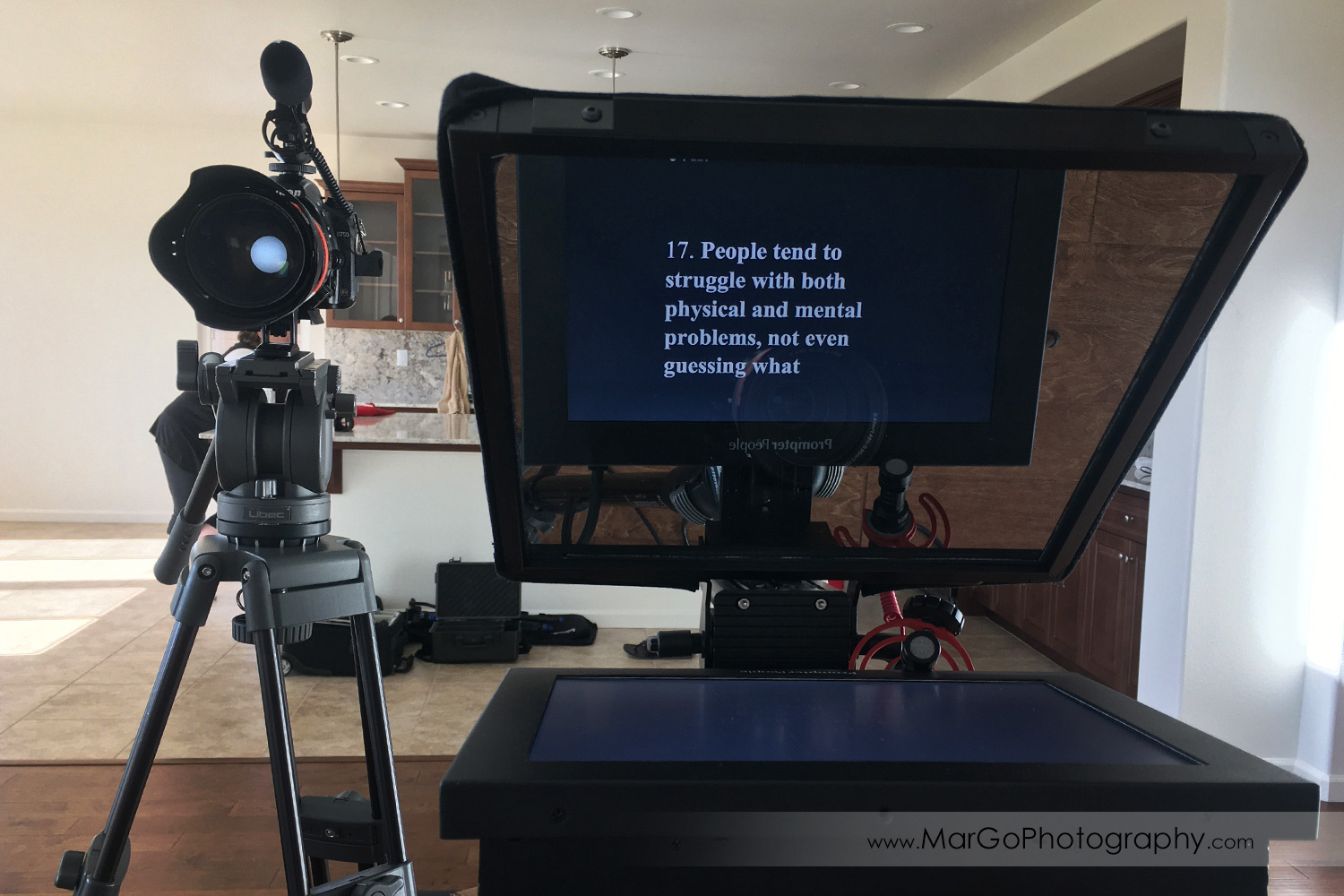photo of two camera with teleprompter video recording setup