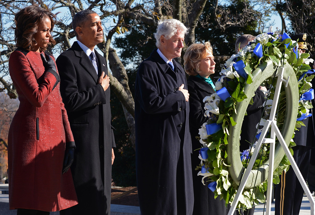 . (L to R)  First lady Michelle Obama, U.S. President Barack Obama, Former U.S. President Bill Clinton and former U.S. Secretary of State Hillary Clinton lay a wreath at the grave site for President John F. Kennedy at Arlington National Cemetery November 20, 2013 in Arlington, Virginia.  (Photo by Pat Benic-Pool/Gett Images)