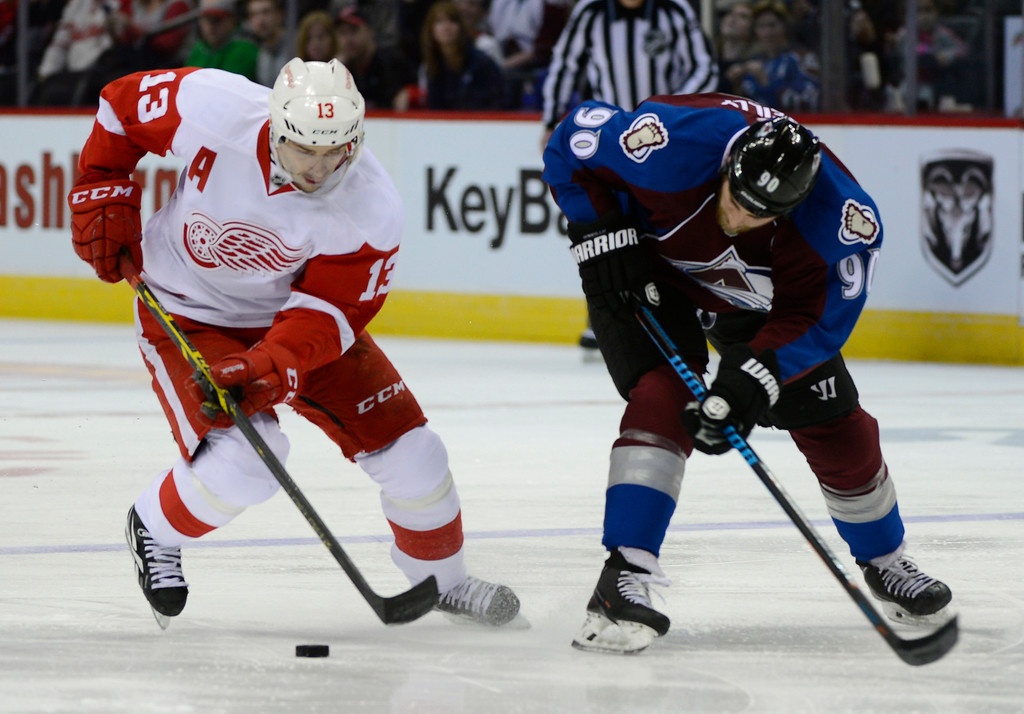 . DENVER, CO - February 5: Detroit Red Wings center Pavel Datsyuk (13) tries to move the puck away from Colorado Avalanche center Ryan O\'Reilly (90) after a failed shot Thursday, February 5, 2015 at the Pepsi Center in Denver, Colorado. (Photo By Brent Lewis/The Denver Post)