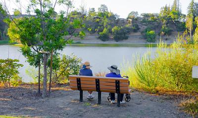 Couple relaxing at Vasona Lake, Los Gatos, California