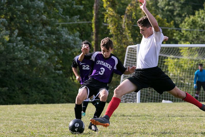 Trivium High School boys soccer played South Lancaster Academy on Thursday afternoon in Lancaster. THS's Oscar Cheffers tries to stop SLA's (3) Aidan Milliron. SENTINEL & ENTERPRISE/JOHN LOVE