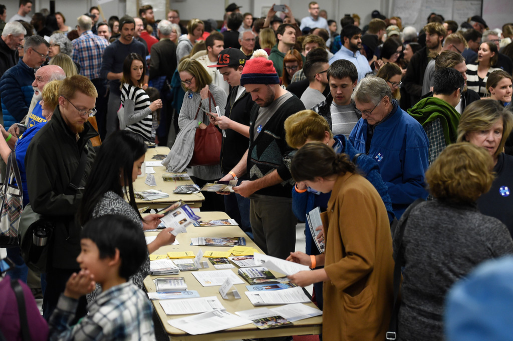 . People look through political material in the overflowing cafeteria during the caucus at East High school in Denver, Colorado on March 1, 2016. 18 precincts were represented at East High School and thousands of people turned out for the caucus. Organizers had anticipated about 20% of people from their precincts would turn out but many more actually came. (Photo by Helen H. Richardson/The Denver Post)