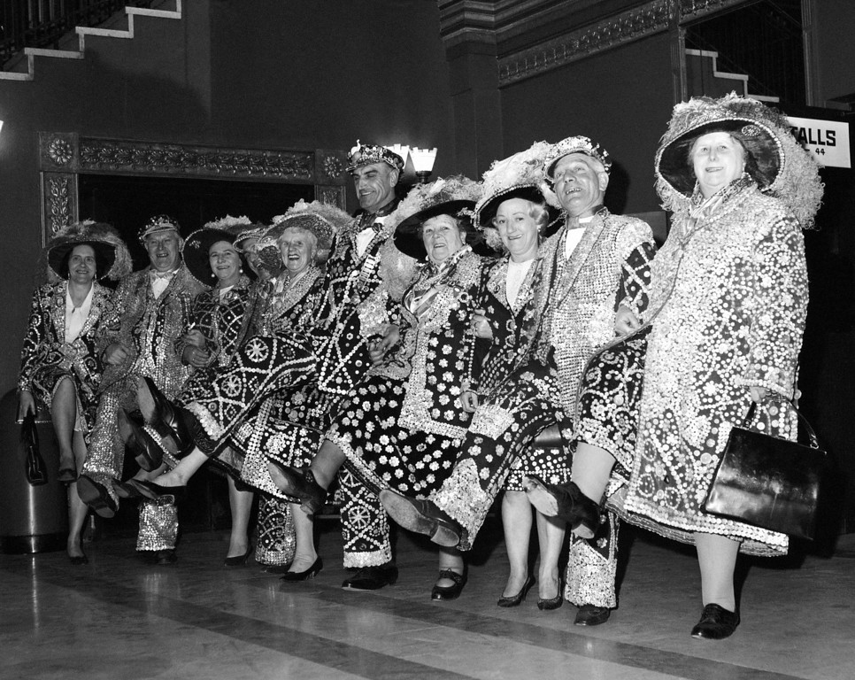 """. Pearly Kings and Queen from London Boroughs do the """"Knees up Mother Brown"""" dance when they attended the premiere of the film \'Up The Junction\' at the Granada, Clapham Junction, London on Jan. 24, 1968. (AP Photo/Staff/Harris)"""