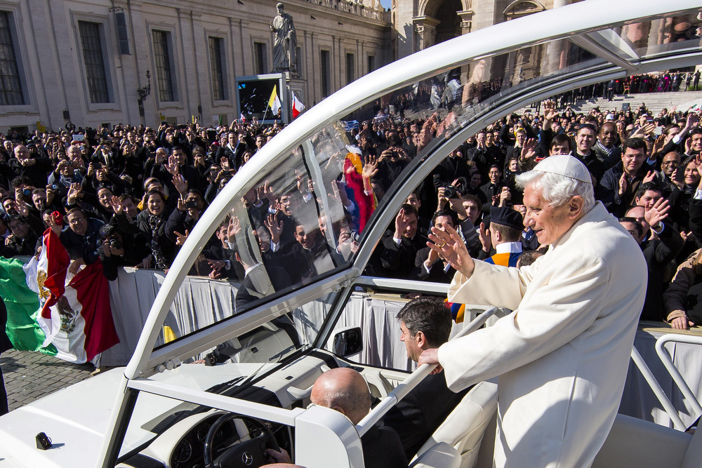 Description of . Pope Benedict XVI travels through the crowd in the popemobile in St Peter\'s Square on February 27, 2013 in Vatican City, Vatican. The Pontiff will hold his last weekly public audience later before he abdicates tomorrow. Pope Benedict XVI has been the leader of the Catholic Church for eight years and is the first Pope to retire since 1415. He cites ailing health as his reason for retirement and will spend the rest of his life in solitude away from public engagements.  (Photo by Carsten Koall/Getty Images)