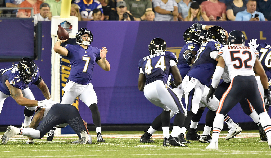 . Baltimore Ravens quarterback Josh Woodrum (7) completes a pass in the first half against the Chicago Bears at the Pro Football Hall of Fame NFL preseason game, Thursday, Aug. 2, 2018, in Canton, Ohio. (AP Photo/David Richard)