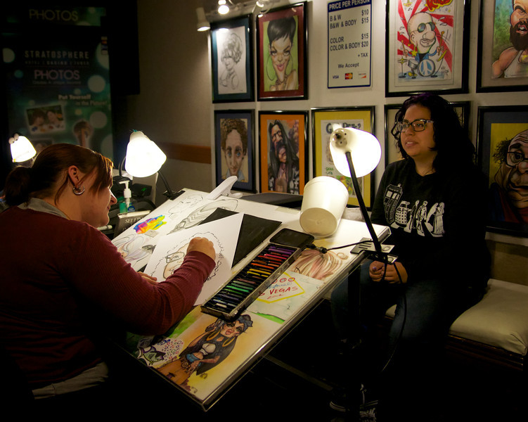 Kaitlyn sits for a caricature