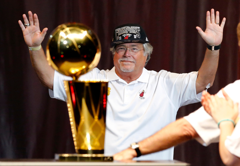 . Miami Heat owner Micky Arison reacts after he was introduced during a celebration at the American Airlines Arena after the Heat\'s NBA Basketball Championship parade in Miami, Florida June 24, 2013. Arison is also the CEO of Carnival Corporation, the world\'s largest cruise operator.  REUTERS/Joe Skipper