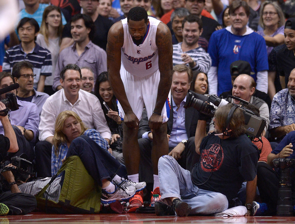 . Clippers#6 DeAndre Jordan gathers himself after flying into the crowd in the 4th quarter. The Oklahoma City Thunder defeated the Clippers 107-101 in a regular season game at Staples Center in Los Angeles, CA. 4/9/2014(Photo by John McCoy / Los Angeles Daily News)